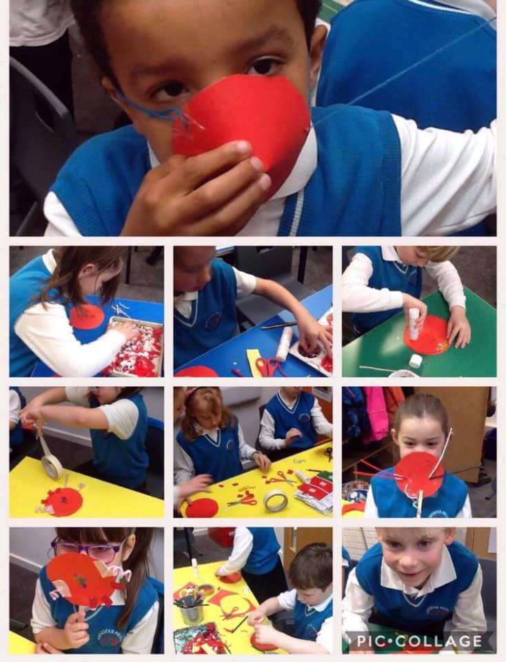 Children making their own red noses